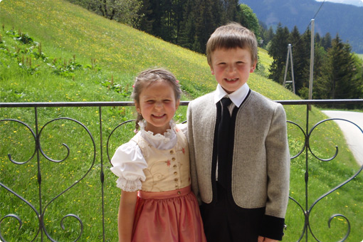 The children of the Greidlerhof on the sun terrace